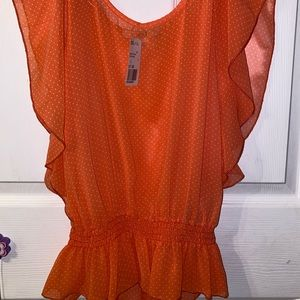 Orange polka-dot blouse